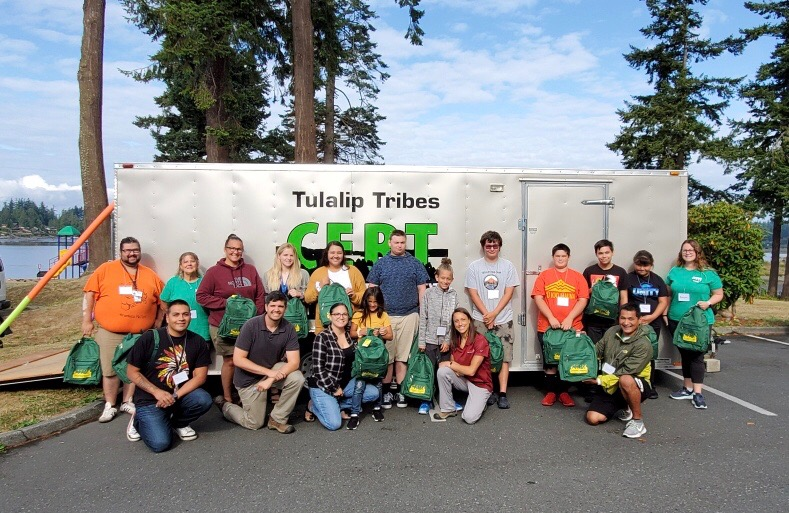 Tulalip Tribe Youth camp participants posed in front of a CERT truck